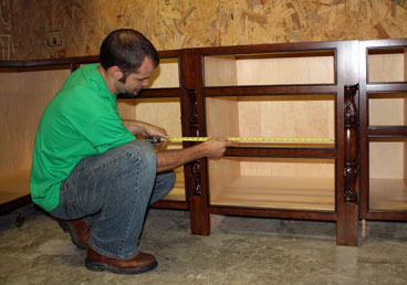 Ryan measures a cabinet